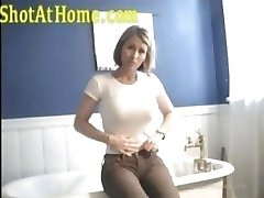 Blonde mom is posing and petting her pussy on homemade video