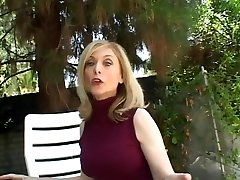 Platinum-blonde housewife sits by the pool when man c