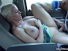 Big tit MILF wanks in van