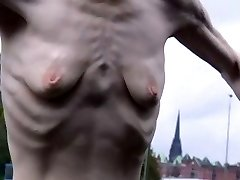 a skinny mature woman with puny empty saggy boobs