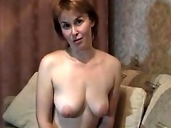 Blonde mature milf at home stripteasing and fingerblasting her pussy