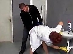 Mature cleaner seduced on the toilet floor