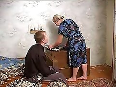 Mature busty lady tempts neighbor boy with big dick into screwing her delicately