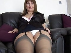 Mature huge-titted secretary talks dirty