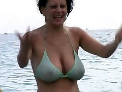 Hot Cougar in Swimsuit at The Beach