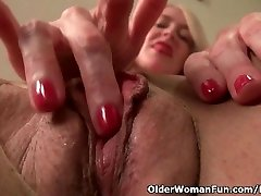 American milf Eva Griffin fingers her nyloned humid pussy