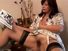 Busty hairy mature brunette honey poses and peels off