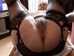 Fur Covered busty mature lady in slip and girdle does upskirt and striptease show