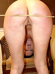 Two young lovelies spanked and caned on their pert round asses