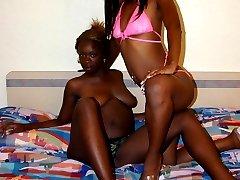 Ebony lesbians put a strap-on to use