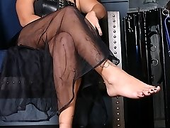Michelle is sitting in her throne wearing a pair of fetish platform boots. She instructs her...