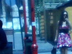 Red Dress walking outdoors