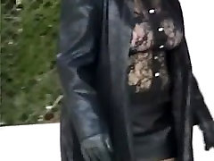 Sexy legs flashing outdoors black leather mini red heels