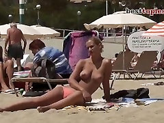 Pretty busty girl Topless on family strokers Beach