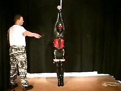 rubber girl bound in bondage