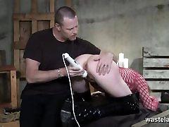 Sex slave in fishnet dress gets spanked