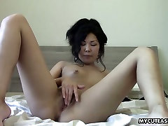 Titless Asian chick takes off at therestaurant and plays with shaved pussy