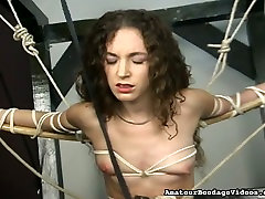 BDSM equipment makes her young body hurt