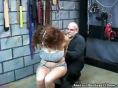 This curvy chick with curly hair seems to be enjoying her ass burning session