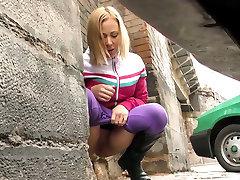 Fair haired dirty bitch makes tenn oral on green car outdoors