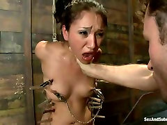 Tied up submissive brunette gets her nipples and pussy lips pinned