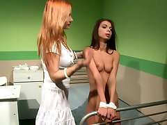 Blonde american folding pulls hair of one sweet looking brunette