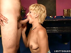 Small titted granny is drilled deep in her cunt in a doggy sex position