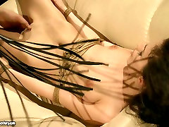 Lascivious brunette is getting punished in hot BDSM way