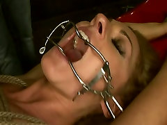 Hussy blonde wench is tied up wearing mouth gag. BDSM