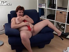 Fat slave branding ass Renate is playing with huge red sex toy