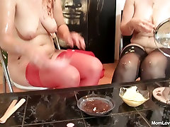 Two Russian milfs smear cream over each others bodies