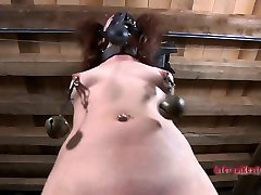 Metal weights stretch Lila Katts puffy nipples to their limits