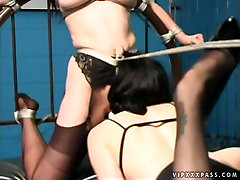 Anastasia Pierce massages her sex slaves pussy with vibrator