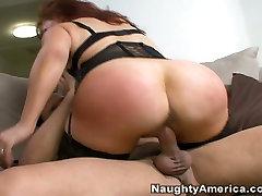 Busty redhead whore Vanessa gives titjob