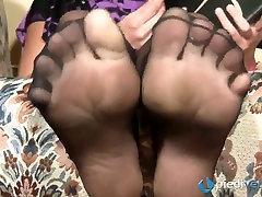 Nasty brunette sweetie Flavia looks irresistible in black nylon tights