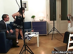 Huge titted woman takes two cocks
