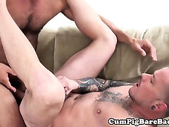 Inked foot king jerks off with a cock in his mouth