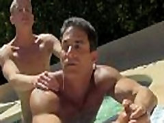 Male models Alex is enjoying the sun on his nude figure when his
