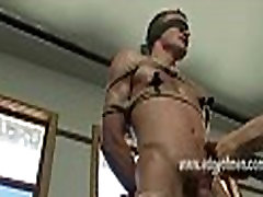Submissive gay guy has his nipples clamped while he is blindfolded and teased