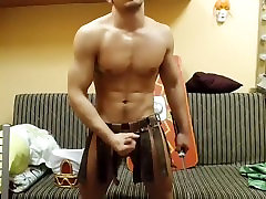 Lovely boy is relaxing in the bedroom and filming himself on web camera