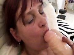 Redhead with huge boobs fucked in her aged pussy hard