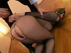 Hot babe in fishnets gets some ass spanking