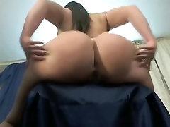 A big-ass gal spanks herself online