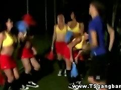 Transsexual cheerleaders practicing their cheering moves