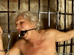 Chunky granny is getting her hairy clam finger fucked. BDSM