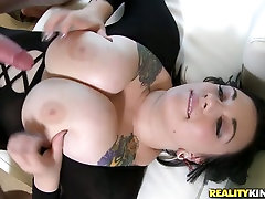 Scarlets works her giant boobs giving awesome titjob