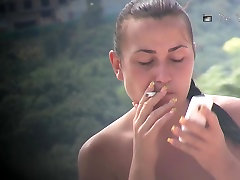Hot sax xxx pak fill girl smoking and talking on the phone