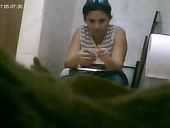 candid toilet cam captures a hot mature woman peeing