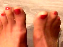 Red nails and feet in tan pantyhose
