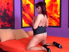 Redhead andas ts fingering herself on the bed